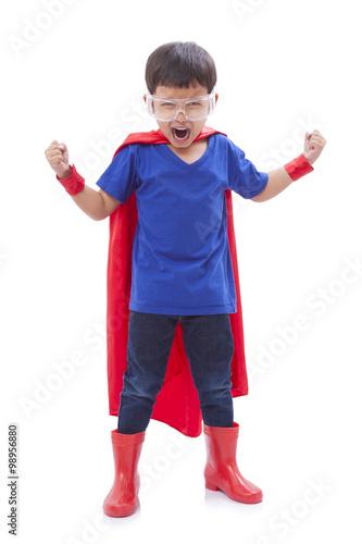 Photo  boy pretending to be a superhero on white background