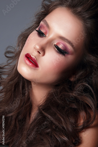 Portrait of a young woman, close-up, bright makeup, eye shadow. Poster