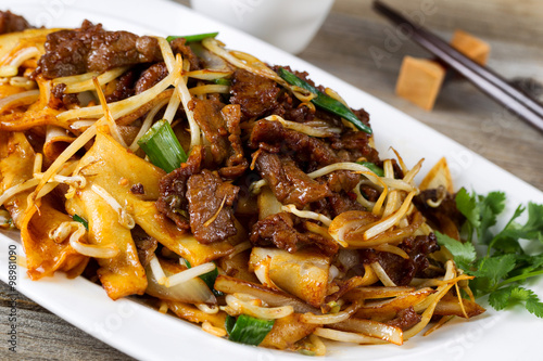 Chinese spicy beef and vegetable dish in plate Canvas Print