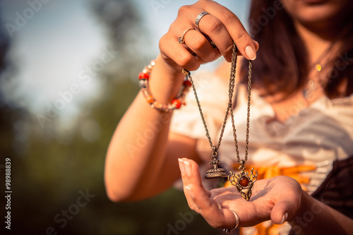 Women's amulet in her hands Canvas Print