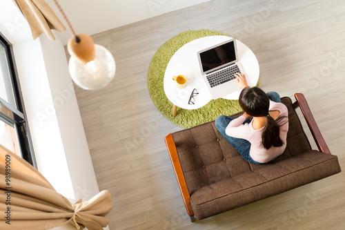 Top view of woman using computer for working at home Poster