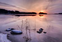 Sunrise At A Partly Frozen Lak...