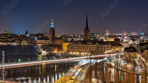 Fotobehang Stockholm Stockholm at Night. Beautiful nightscape of Stockholm city center, the Venice of the North. From left to right, Kungsholmen, Stockholm City Hall, Riddarholmen and Gamla Stan are pictured here.