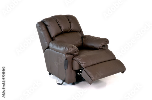 Fotografie, Obraz  Brown reclining leather chair with controls on white background