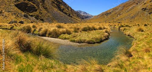 Valokuva  beautiful mountain valley landscape with stream