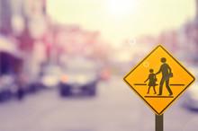 School Sign On Blur Traffic Road Background.