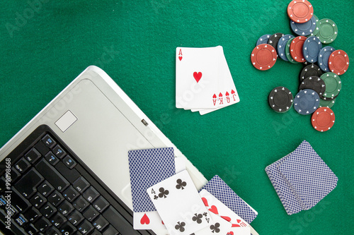 фотография  Image related to classic and online casino  games  on a green background from a