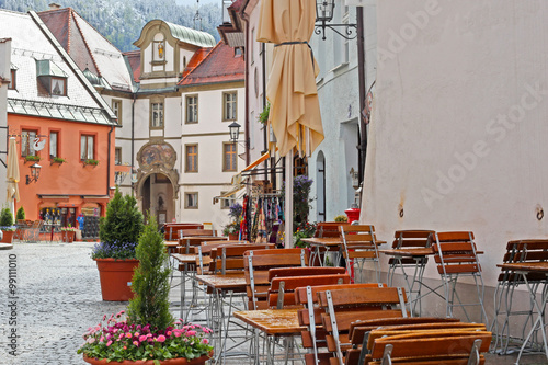 Photo sur Toile Drawn Street cafe Beautiful colorful houses in Fussen, Bavaria, Germany