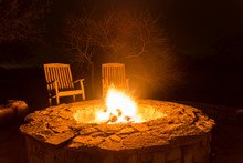 Fire Pit Aflame With Two Empty...