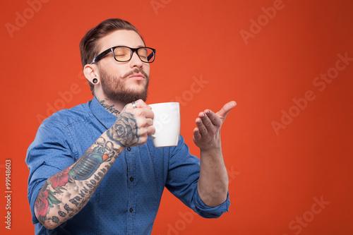 Carta da parati  Cute bearded man is smelling hot drink