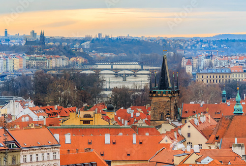 Staande foto Praag Traditional red roofs in old town of Prague and river Vltava