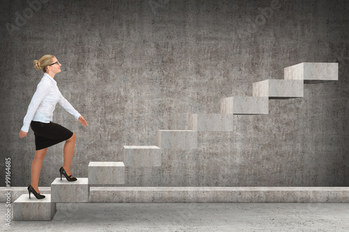 Fotografie, Obraz  Business person stepping up a staircase. business concept