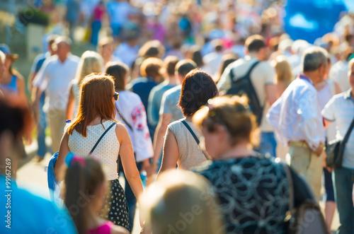 People walking on the city street Fototapeta