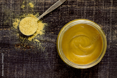 Mustard Russian island on a wooden table, top view. Poster