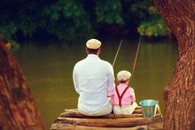 Cute Father And Son Fishing To...