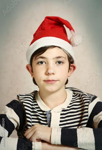 Fotografie, Tablou  close up portrait of a preteen boy in santa hat