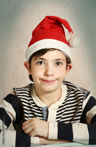 Fotografie, Tablou  close up portrait of a preteen boy in santa hat