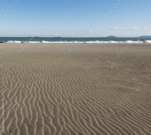 Spoed Foto op Canvas Noordzee Sand and sea waves.