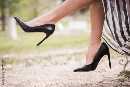 Fotografie, Tablou Black high heels on the feet of a young woman