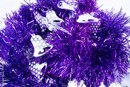 Purple holiday decoration ribbon on white background