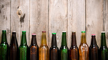 Beer Bottles On Wooden Table .