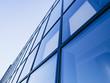 Leinwanddruck Bild - Architecture detail Modern Glass facade Background Blue tone