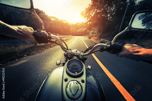 Motorcycle on the empty asphalt road Poster