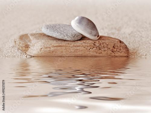 Foto op Plexiglas Stenen in het Zand Zen stone stack and sand, water reflections