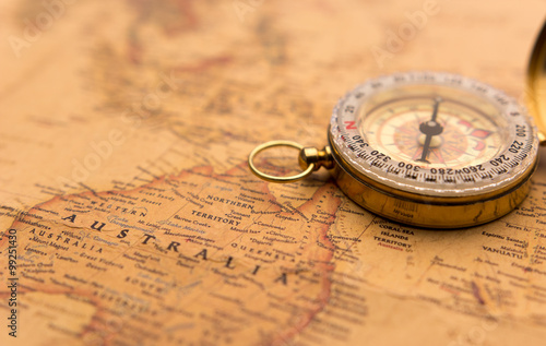 Old compass on vintage map selective focus on Australia #99251430