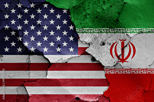 Fotografía  flags of USA and Iran painted on cracked wall
