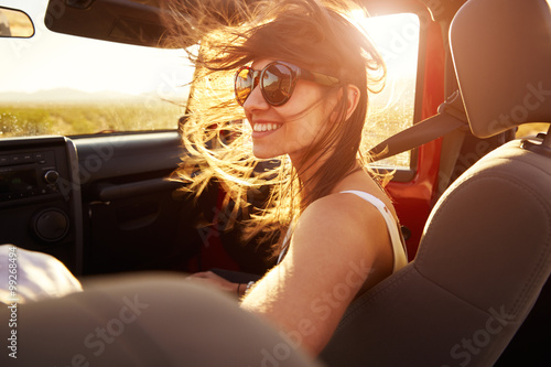 Fotografia, Obraz  Woman Passenger On Road Trip In Convertible Car