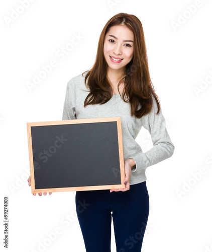 Valokuva  Woman showing with chalkboard