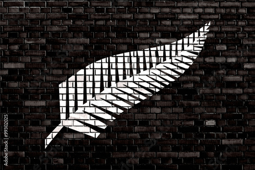 Poster Océanie flag of Silver fern painted on brick wall