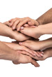 canvas print picture Teamwork, close up of many human hands stacked togheter