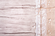 Lace, Pearls, Bowknot, Canvas, Sackcloth On Wooden Background. Rustic Design. Free Space For Your Text