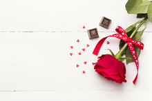 Red Rose, Chocolates On A White Wooden Background