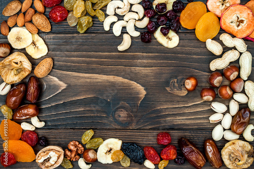 Mix of dried fruits and nuts on a dark wood background with copy space Canvas Print
