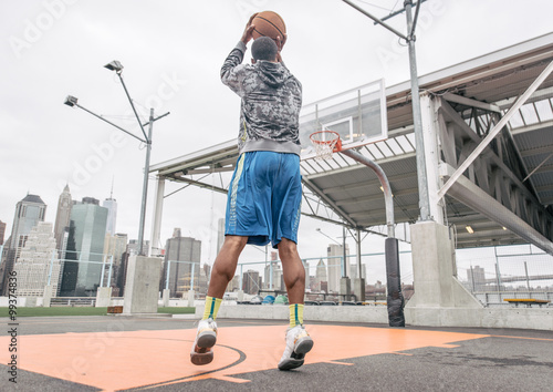 Basketball player playing on the court Poster