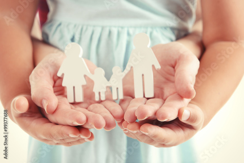 Concept of united family - figures of parents and kids in girls and mothers hand Canvas Print