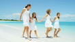 Caucasian family mother girls white clothes beach ocean island vacation tourism