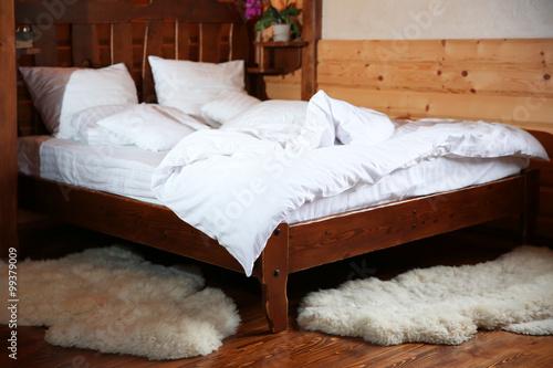 Fototapeta Detail of mountain wooden lodge bedroom obraz na płótnie
