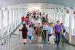 Blurred background of people walking in rush hour.