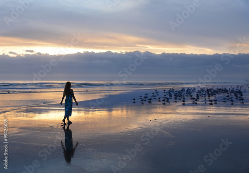 Woman Relaxing On The Beach At Sunrise Daytona Florida