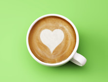 Heart Shape Coffee Cup Concept Isolated On Green Background