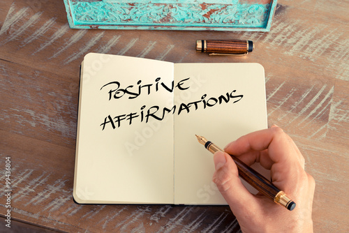Photo Motivational concept with handwritten text POSITIVE AFFIRMATIONS