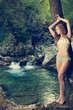Lady nature - beoutiful young wman dressed in swimwear stands in