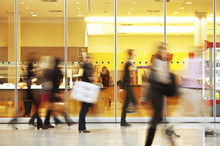 Intentional Blurred Image Of People In Shopping Center