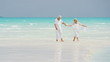 Senior Caucasian couple walking together on an island beach