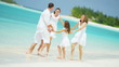 leisure travel promotion beach ocean Caucasian happy family parents young girls