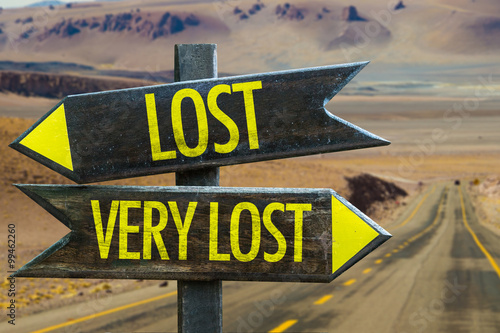 Valokuva  Lost - Very Lost signpost in a desert background